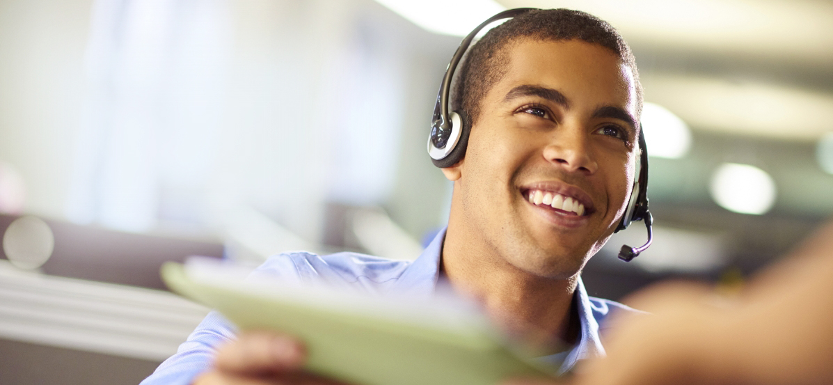 Moneytree customer service representative smiling in a call center.